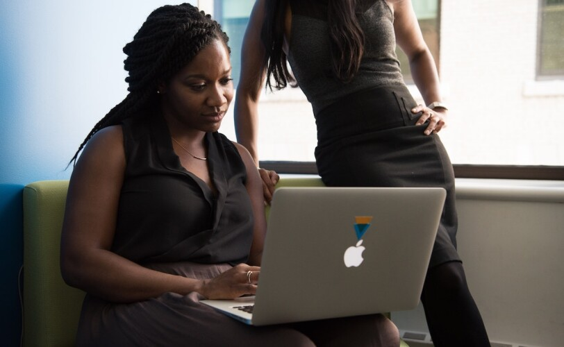 Image of two women working on a laptop