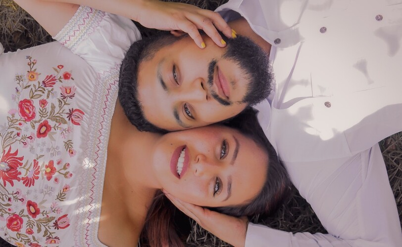 Couple lying on the ground