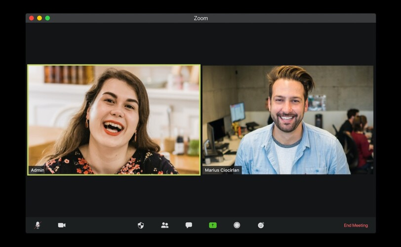 Image of two people on a virtual meeting.