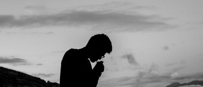 silhouette of man smoking