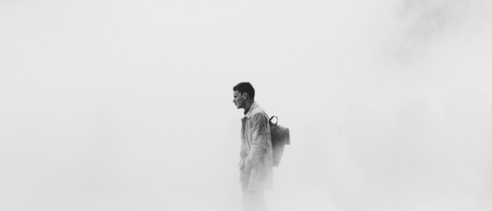 Man standing in fog
