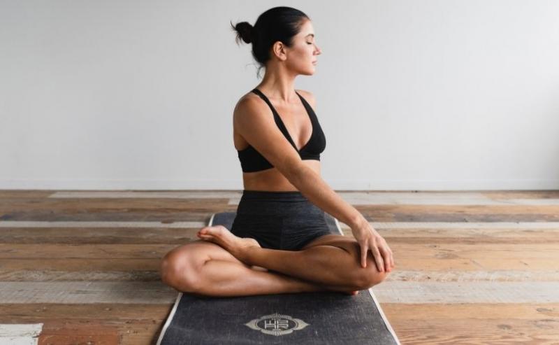 Woman twisting on yoga mat