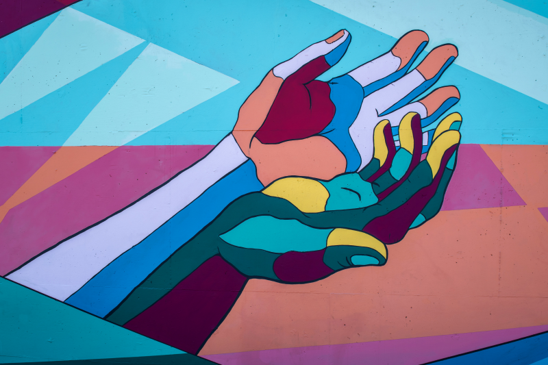 Painting of two hands reaching out