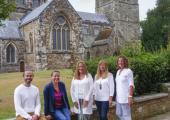 Alexa Warner and her Healthful Mind Clinic team outside Wimborne Minster