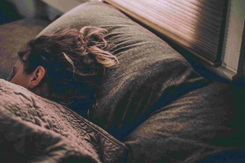 a woman tries to sleep