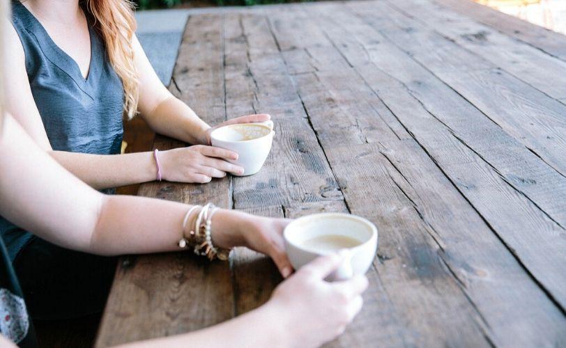 Two women enjoying a cup of coffee
