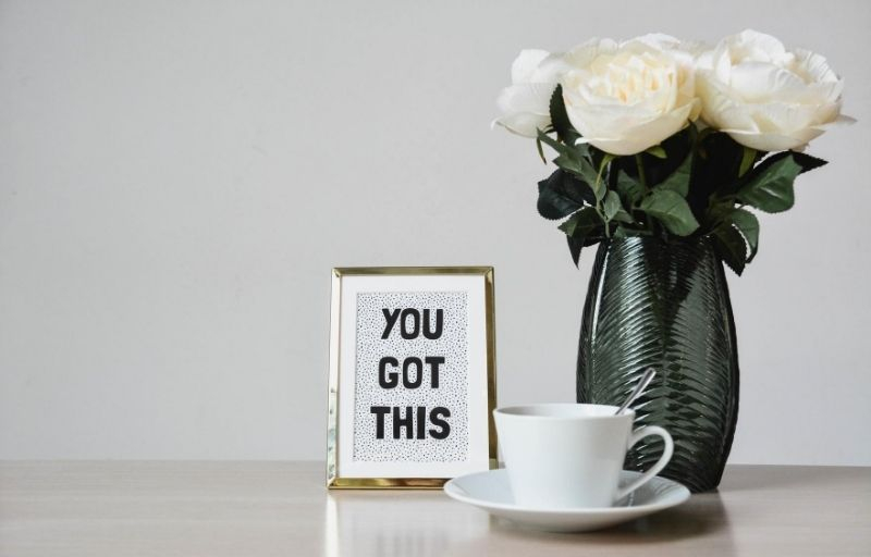 A motivational frame: You got this, sits next to flowers