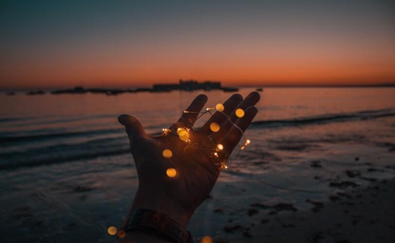 Hand holding jar of lights