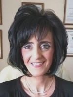 Karen April Mills CNHC Registered MBBRS