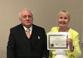 Dr Richard Bandler (Co-creator of NLP) awarding June O'Driscoll - Licensed Master Trainer of NLP