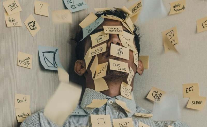 Man with post it notes all over face