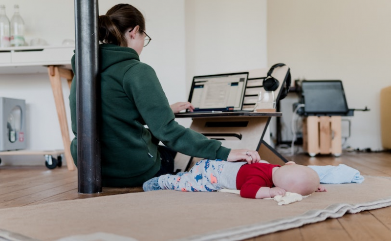 Mum working with laptop and baby