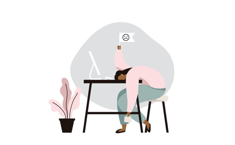 Woman feeling overwhelmed with head on desk