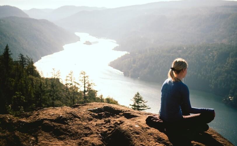 Woman sat on mountain