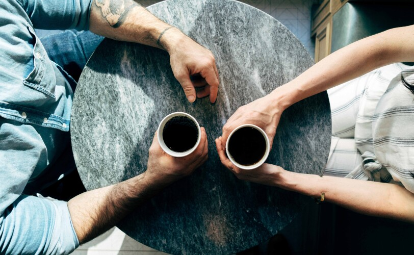 Man and woman having coffee