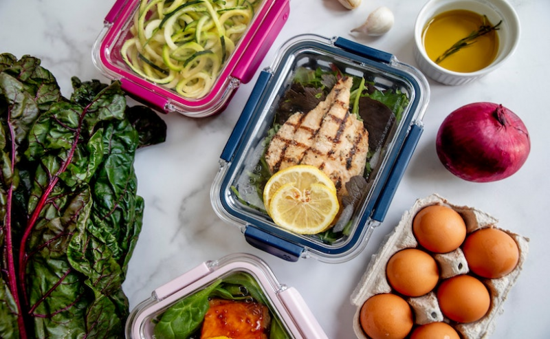 Healthy foods laid out in lunchboxes