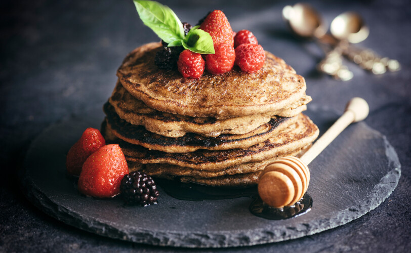 Buckwheat pancakes with berry fruit and honey