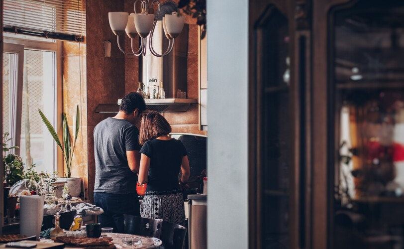 Image of a couple cooking together in a kitchen