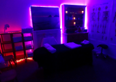 Mood lighting is set for warm and relaxing full body massage