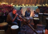 Lee playing one of the many instruments during a healing sound session.