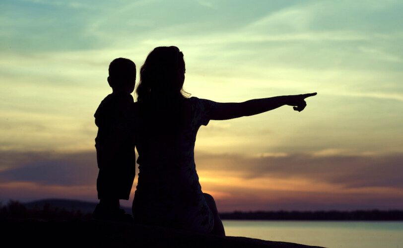 Silhouette of mother and son